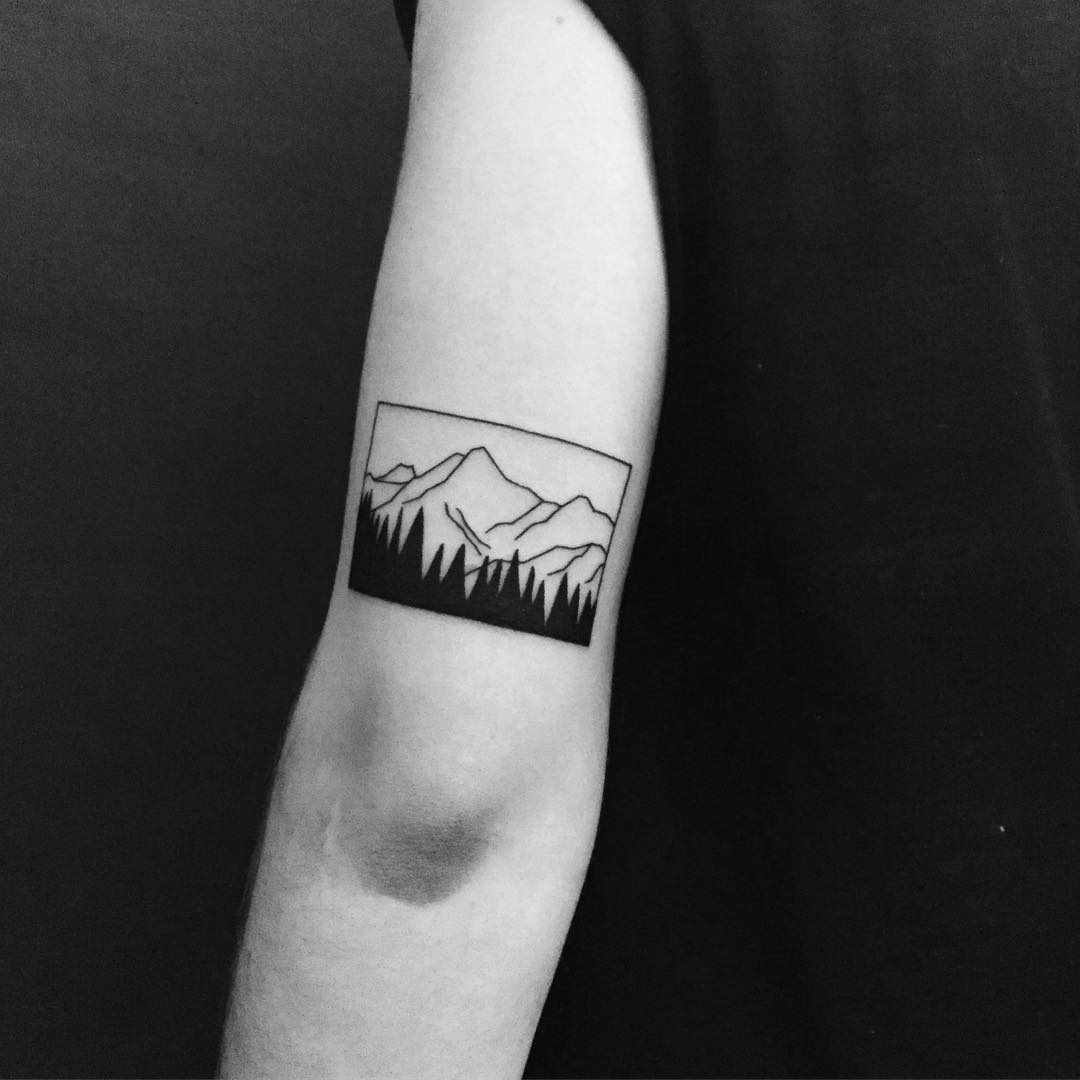 Beautiful minimal mountain tattoo by Chinatown Stropky