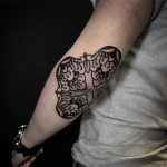 Black elbow tattoo by Jaya Suartika