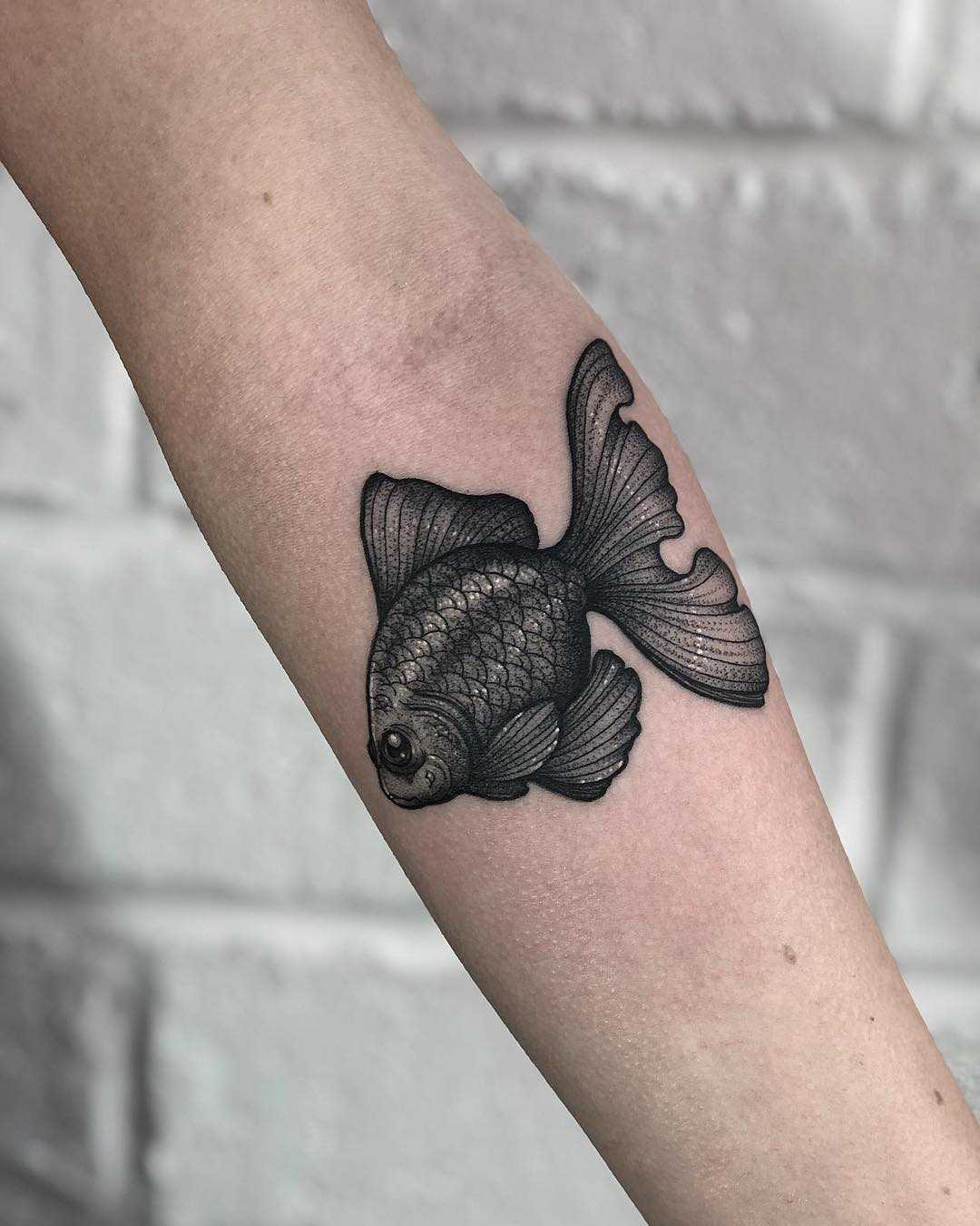 Black telescope fish tattoo by Lozzy Bones