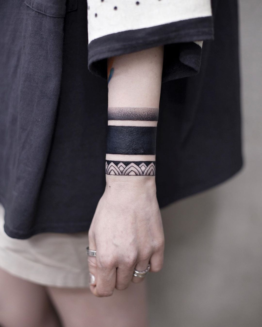 Blackwork bracelet tattoo by Aki Wong