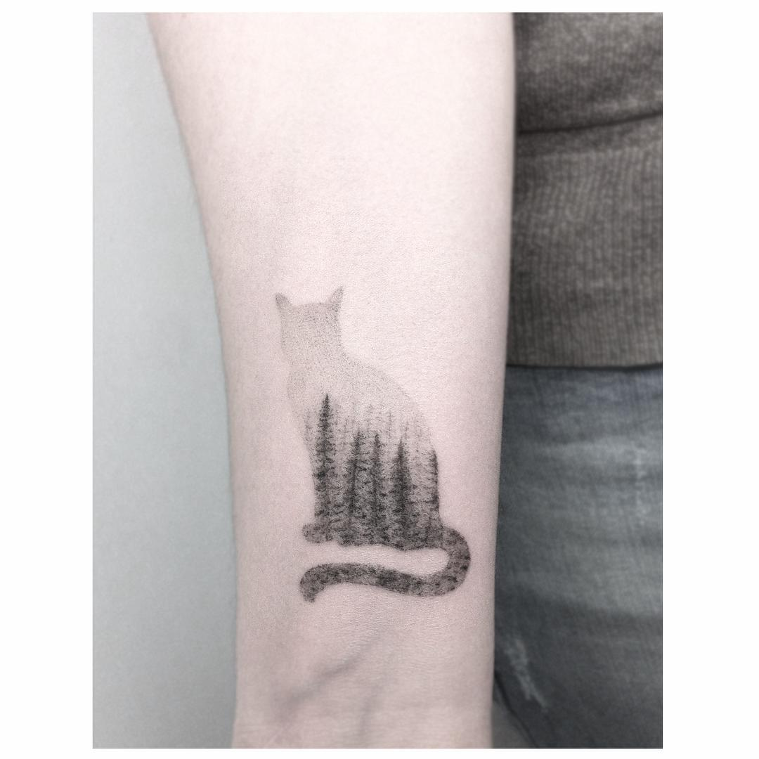 Cat and forest tattoo by Jakub Nowicz