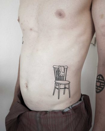 Chair with pants tattoo by Ann Gilberg