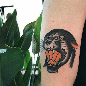 Classic panther tattoo by Łukasz Krupiński