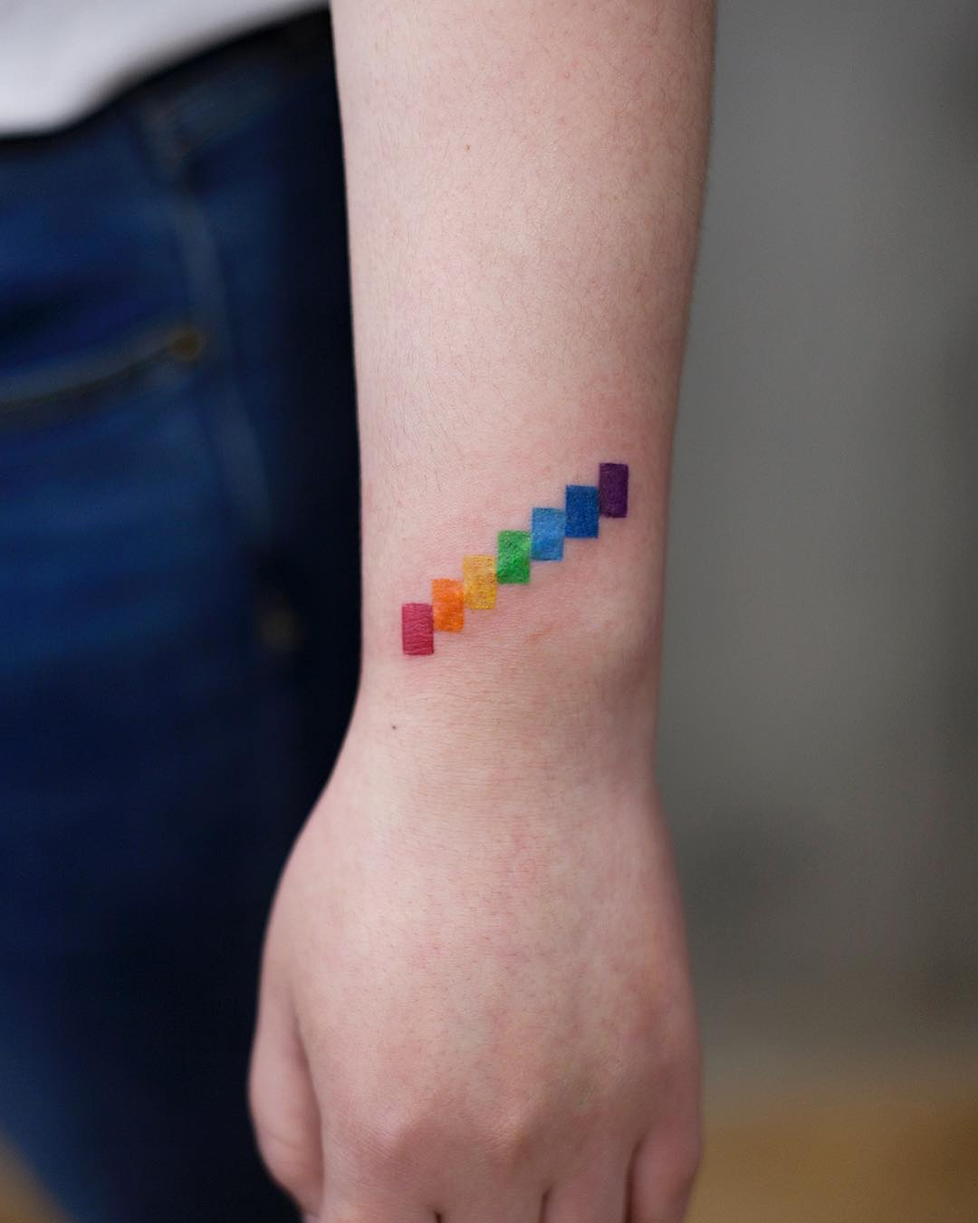 Cover up rainbow tattoo by Aki Wong