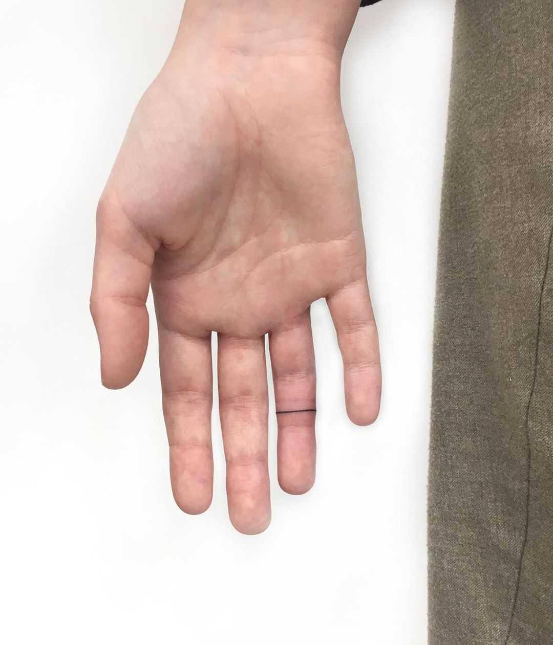 Finger band tattoo by Gianina Caputo