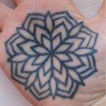 Flower tattoo on a palm by Luke.A.Ashley