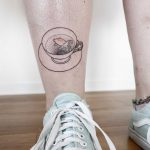 Goldfish in a teacup tattoo by Ann Gilberg