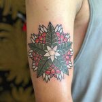 Green and red flower by tattooist Jayaism