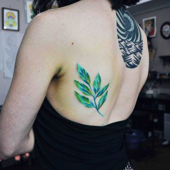 Green branch tattoo by Valeria Yarmola
