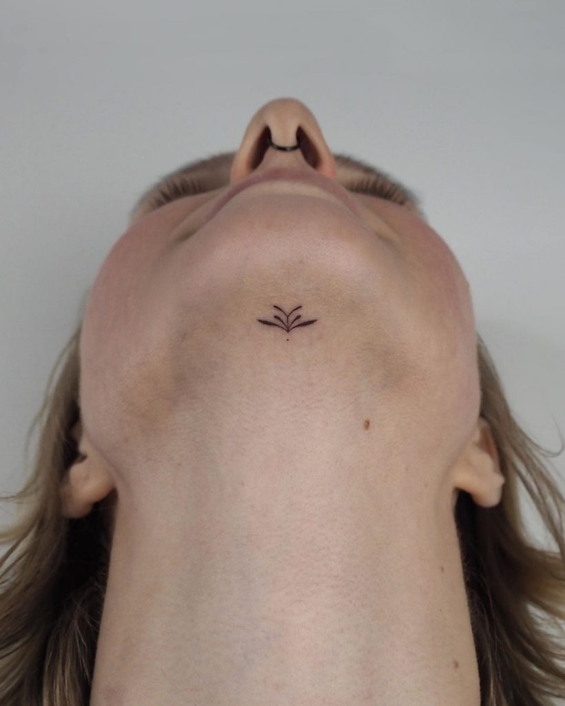 Hand-poked chin tattoo by Lara Maju