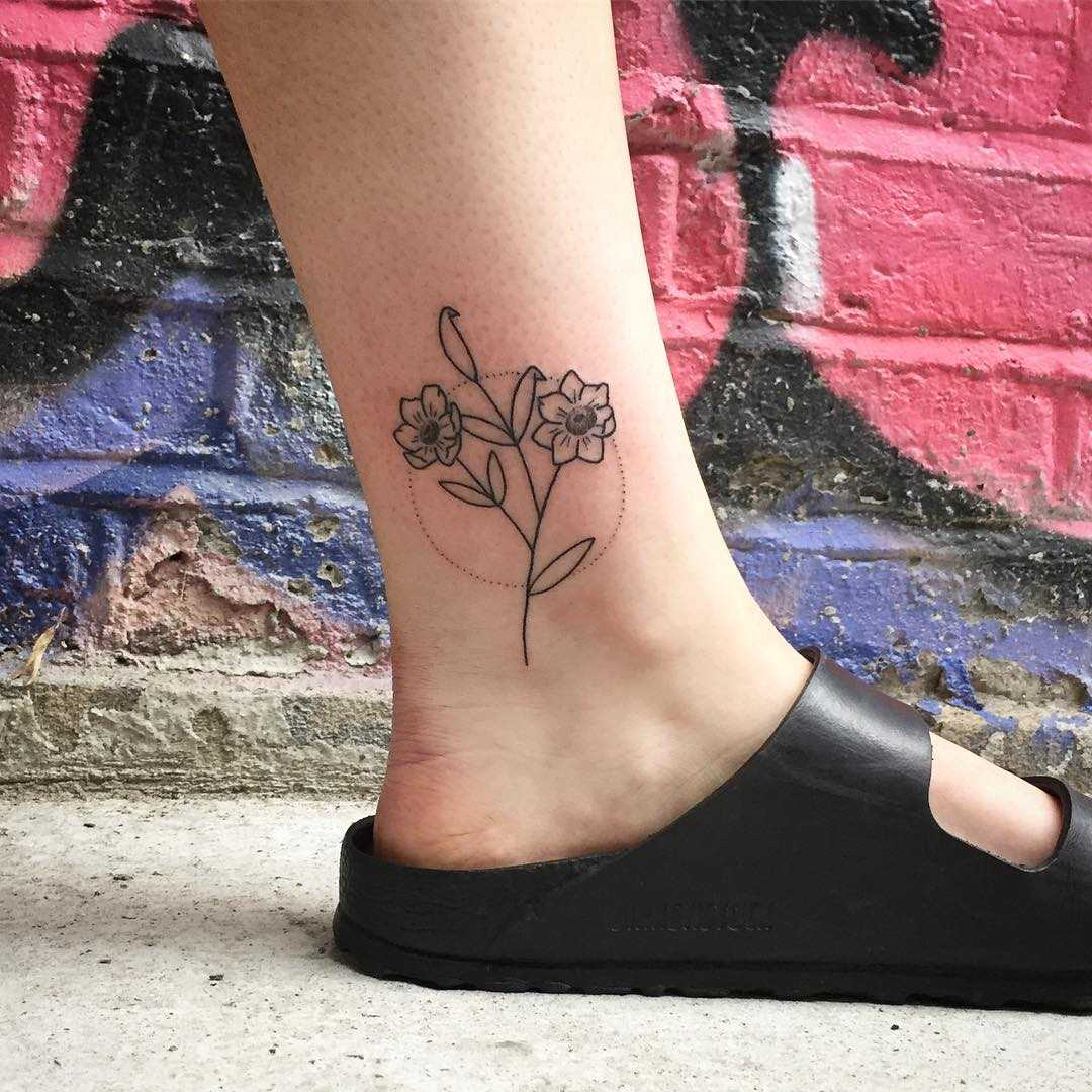 Hand-poked flower tattoo on an ankle by Kirk Budden