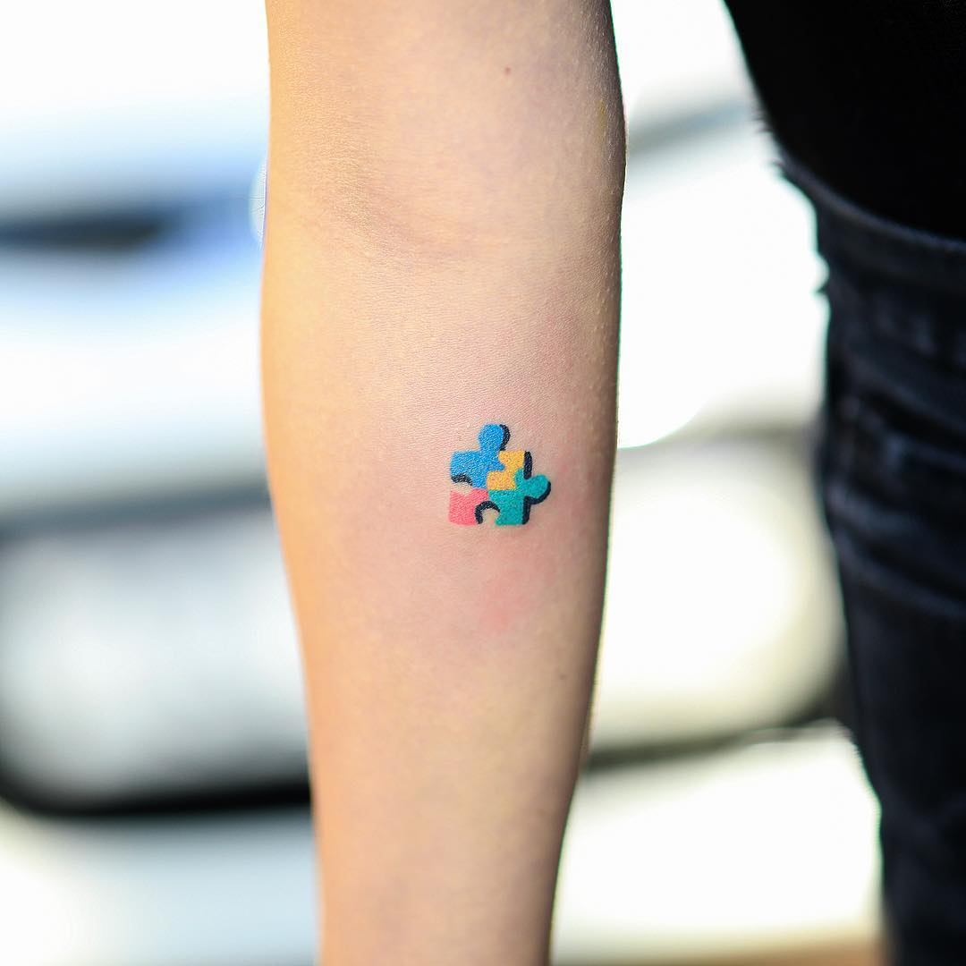 Hand-poked puzzle piece tattoo by zzizziboy