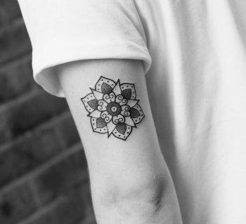 Little mandala tattoo on a triceps by Wagner Basei