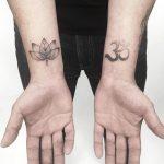 Lotus and om tattoos by Gianina Caputo