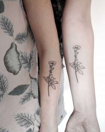 Matching buttercup tattoos by Ann Gilberg