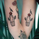 Matching cactus tattoos by Dżudi Bazgrole