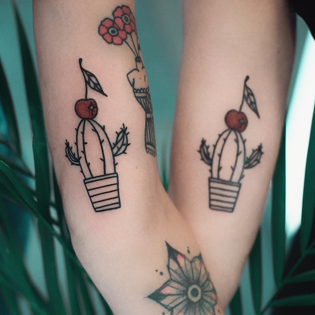 Matching cactus tattoos by Dżudi Bazgrole