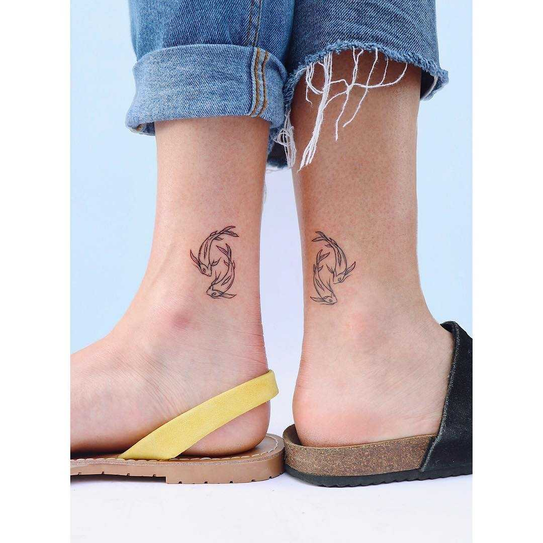 Matching sister Pisces tattoos by artist Zaya