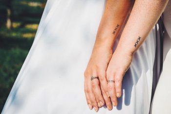 Matching xxx tattoos by Kirk Budden
