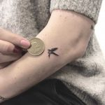 Micro swallow tattoo by Annelie Fransson