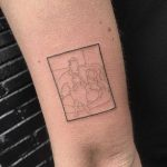 Minimal portrait tattoo by Robbie Ra Moore
