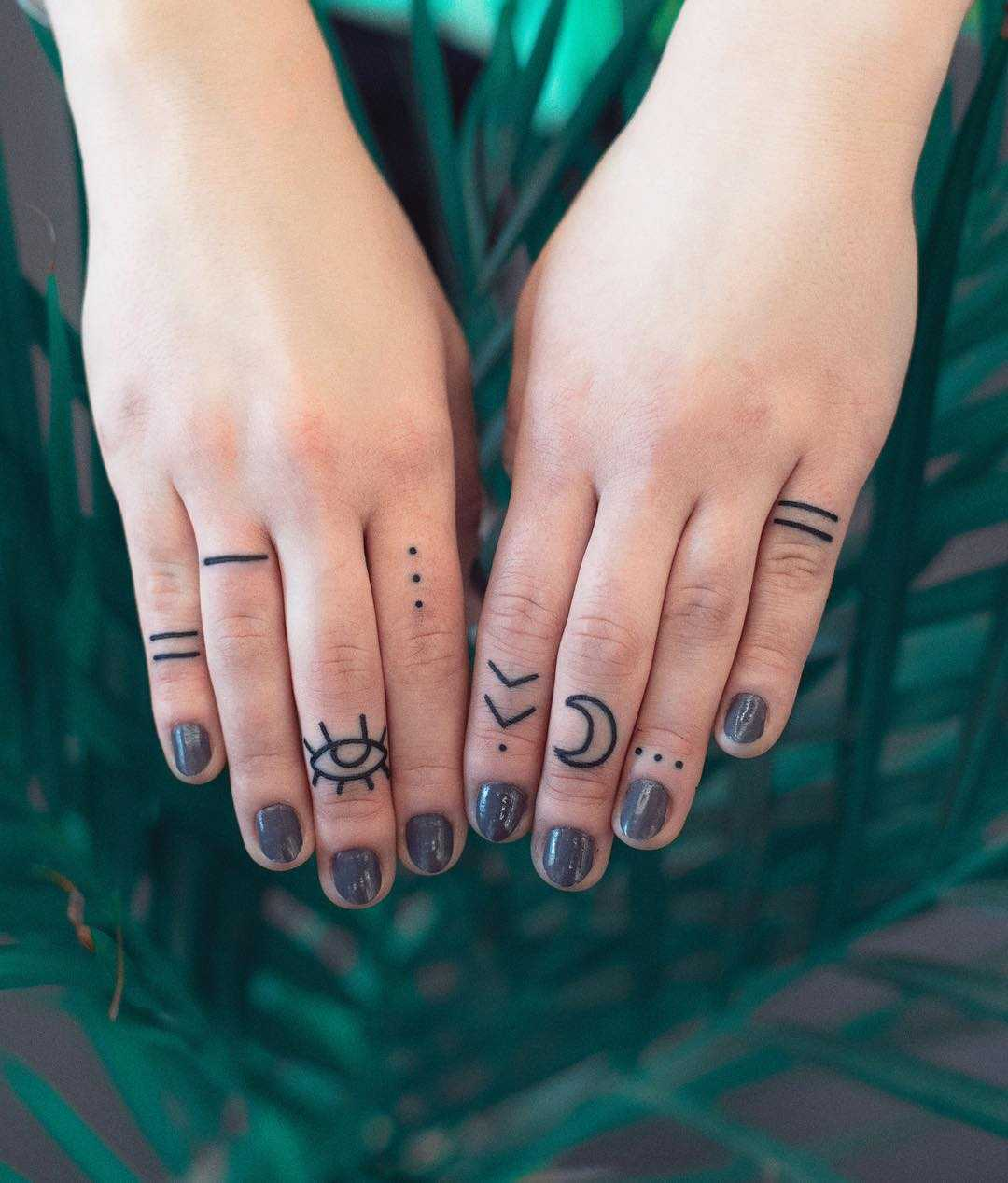 Minimalist finger tattoos by Dżudi Bazgrole