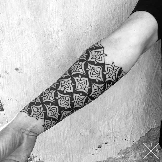 Negative space pattern tattoo by Jaya Suartika