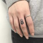Number 8 tattoo by Gianina Caputo