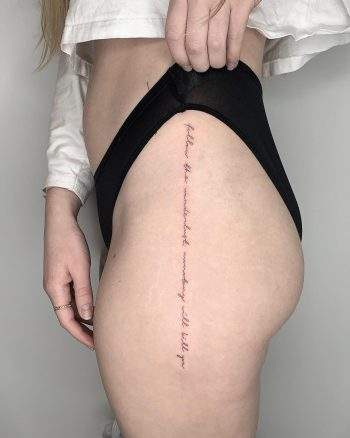 Quote tattoo on a hip by Conz Thomas
