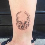 Skull on an ankle by Suki Lune