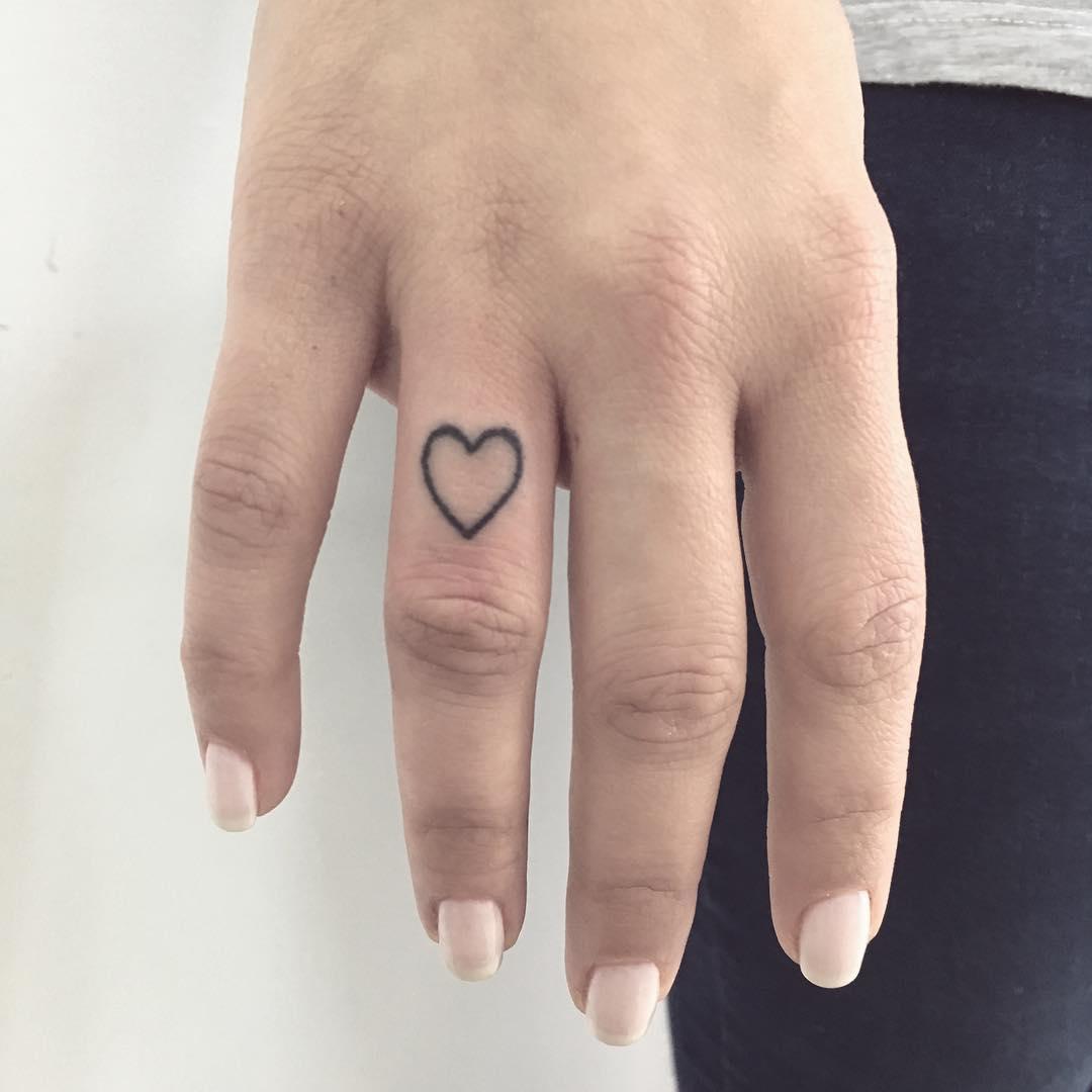 Small heart tattoo by Gianina Caputo