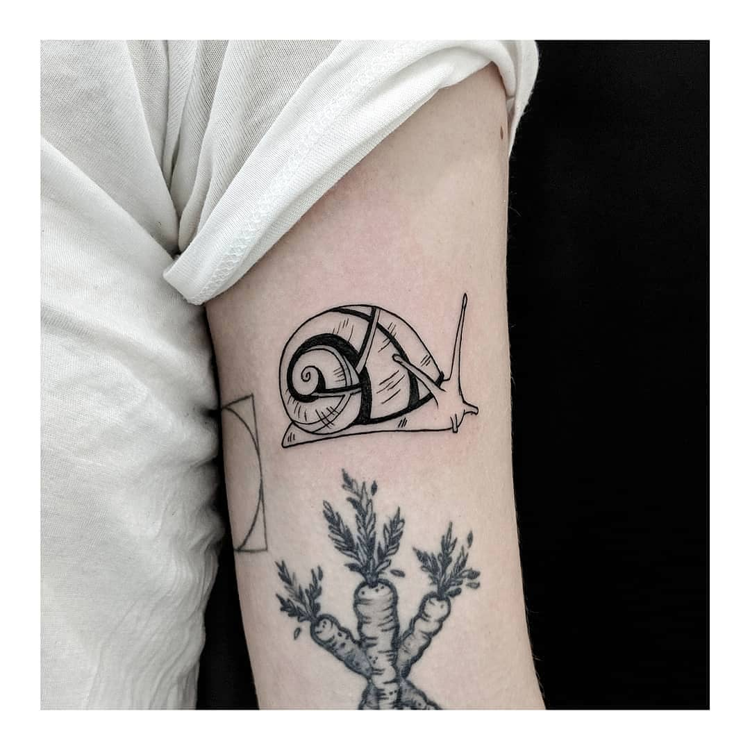 Snail buddy tattoo by Sabrina Parolin