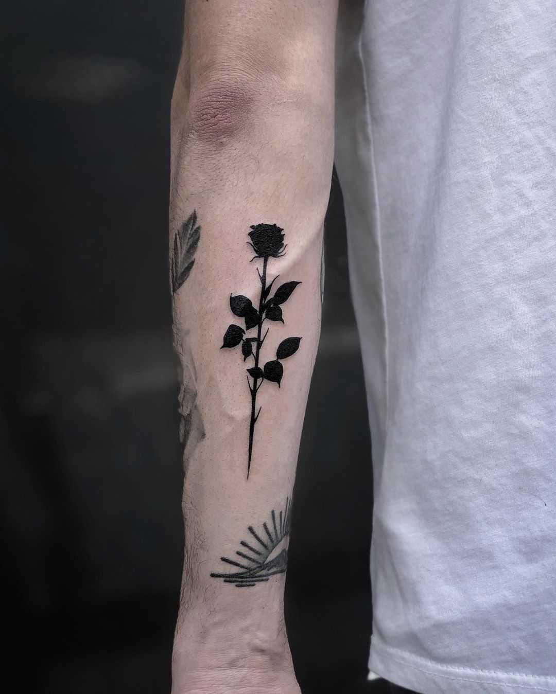 Solid black rose tattoo by Loz McLean
