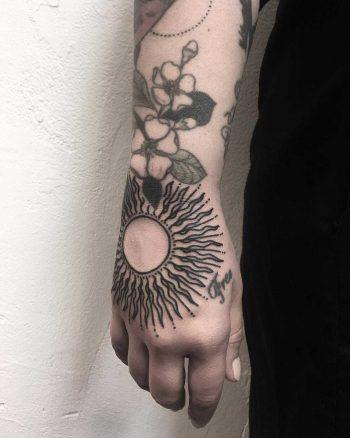 Stylized sun by tattooist Spence @zz tattoo