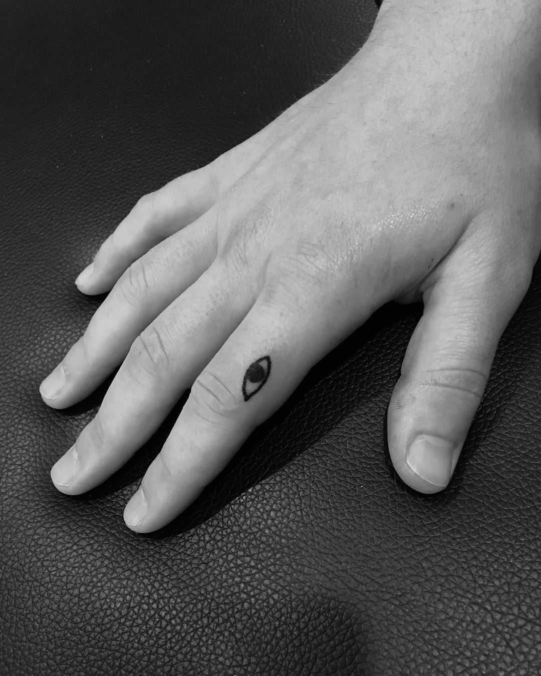 Tiny eye tattoo by Robbie Ra Moore