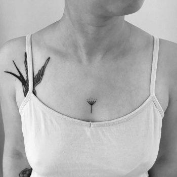 Tiny umbel tattoo by Nadia Rose