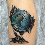 Traditional globe tattoo by Łukasz Krupiński