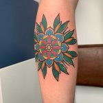 Traditional mandala flower tattoo by Lara Simonetta