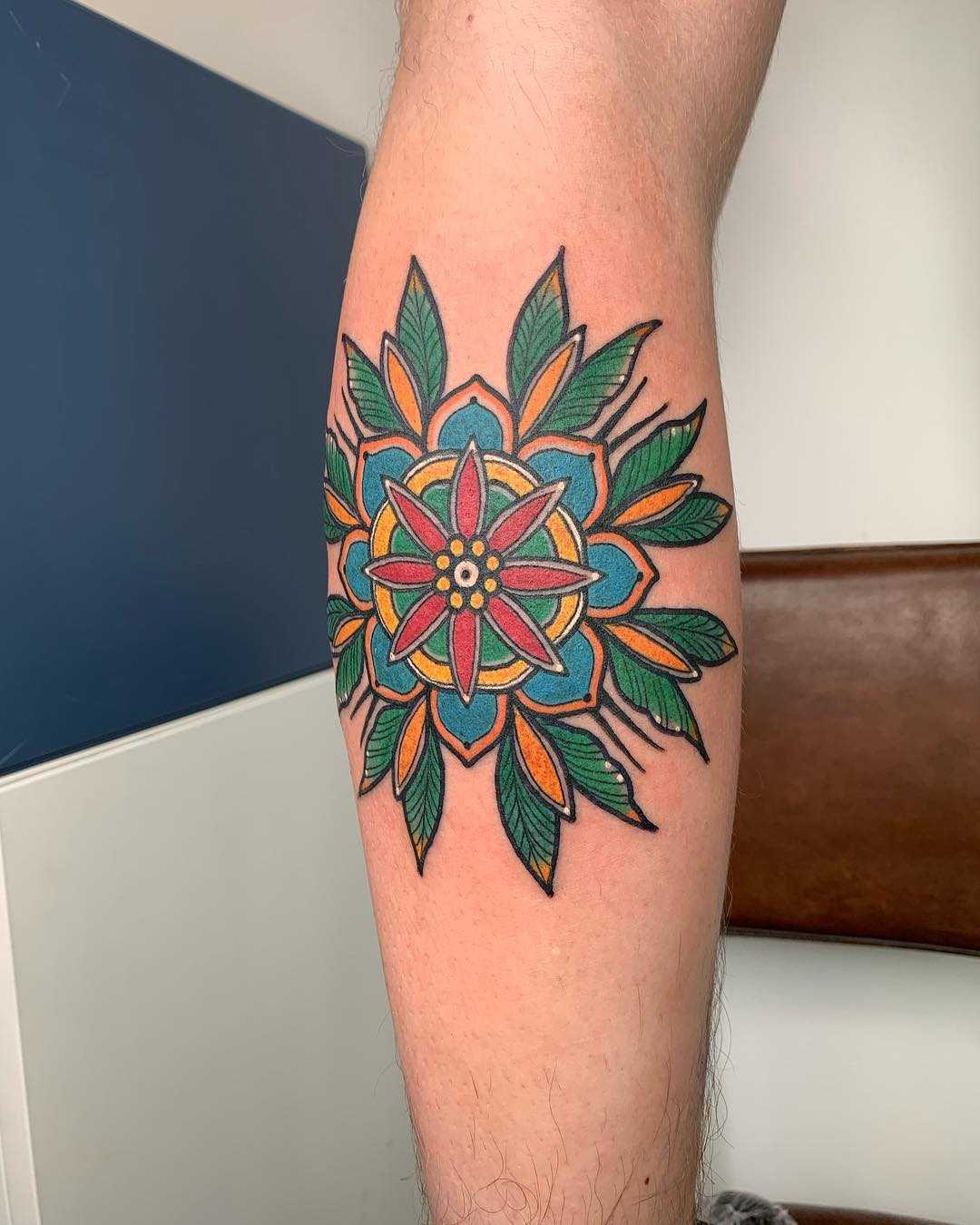 Traditional mandala flower tattoo by Lara Simonetta