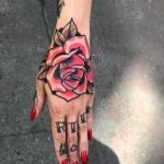 Traditional pink rose tattoo by Mike Nofuck