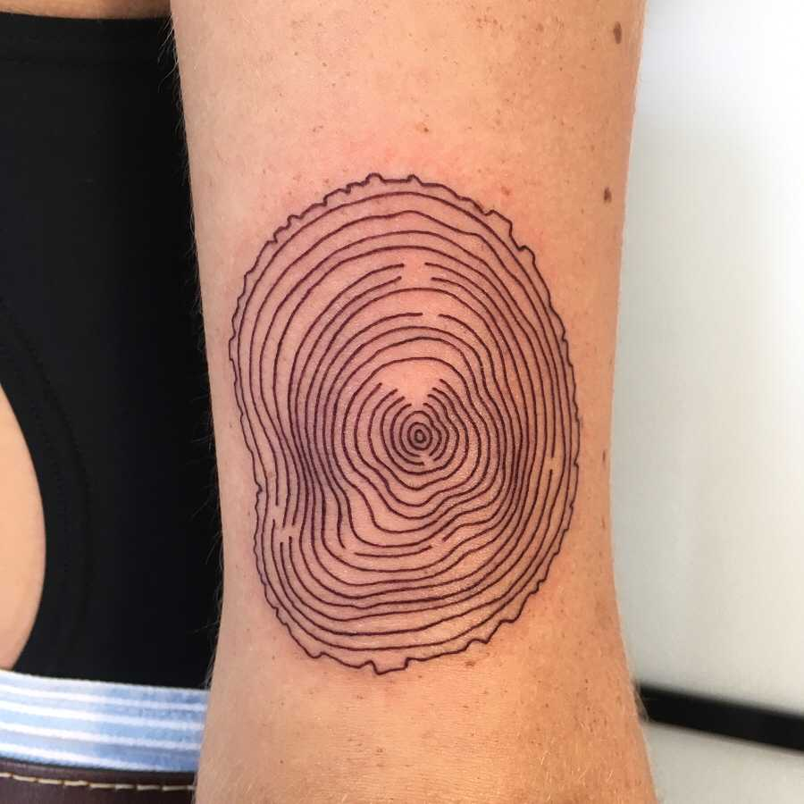 Tree ring tattoo by Agata Agataris