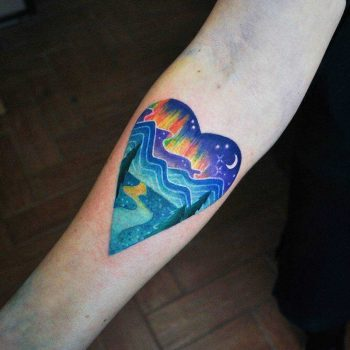 Watercolor heart landscape tattoo by Valeria Yarmola