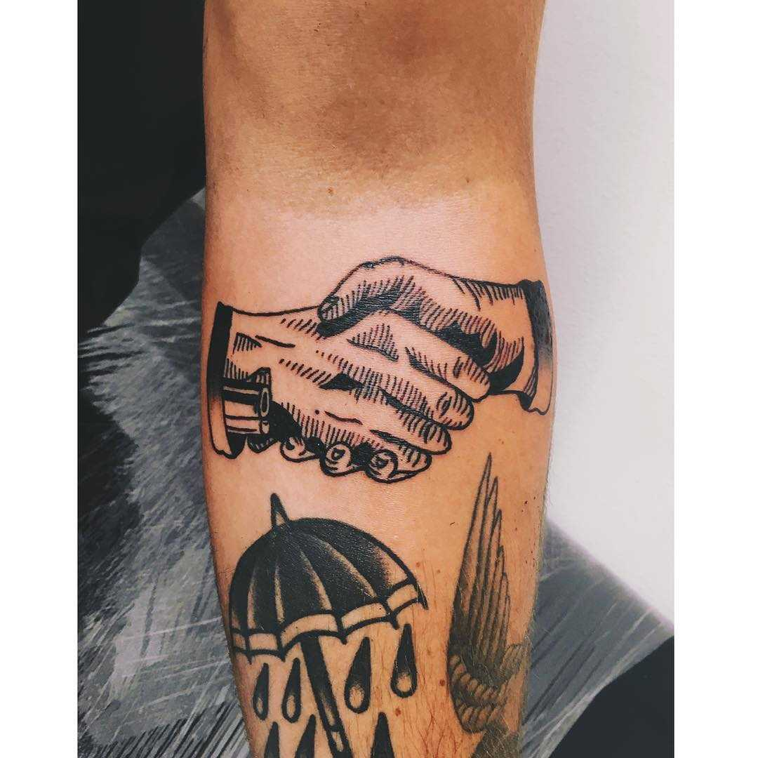 Woodcut handshake tattoo by tattooist Zaya
