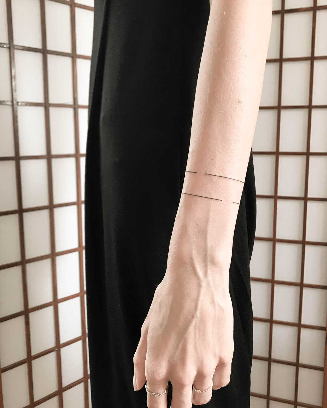 Wrap around with holes ️tattoo by Ann Gilberg
