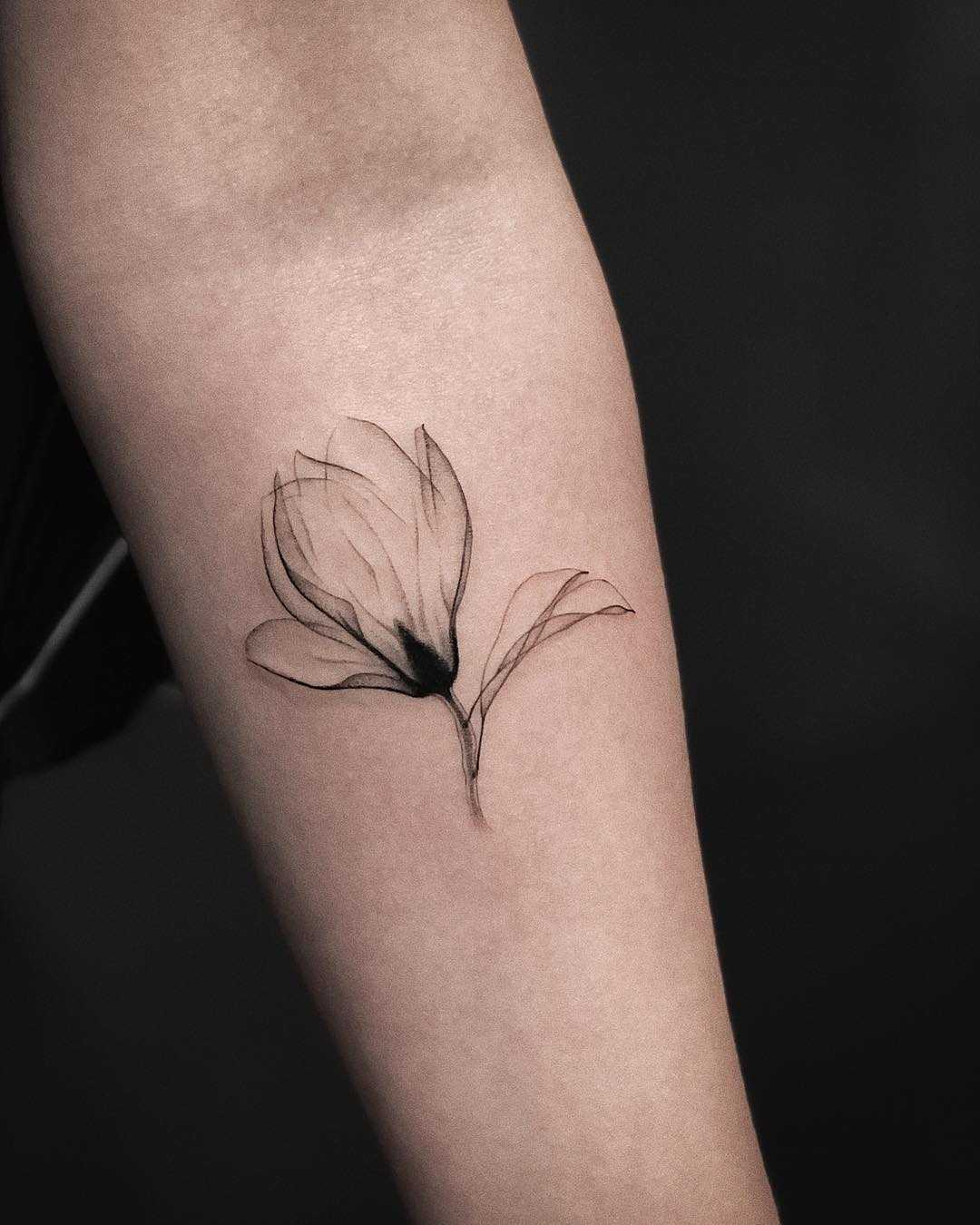 X-ray Magnolia flower tattoo by Jakub Nowicz
