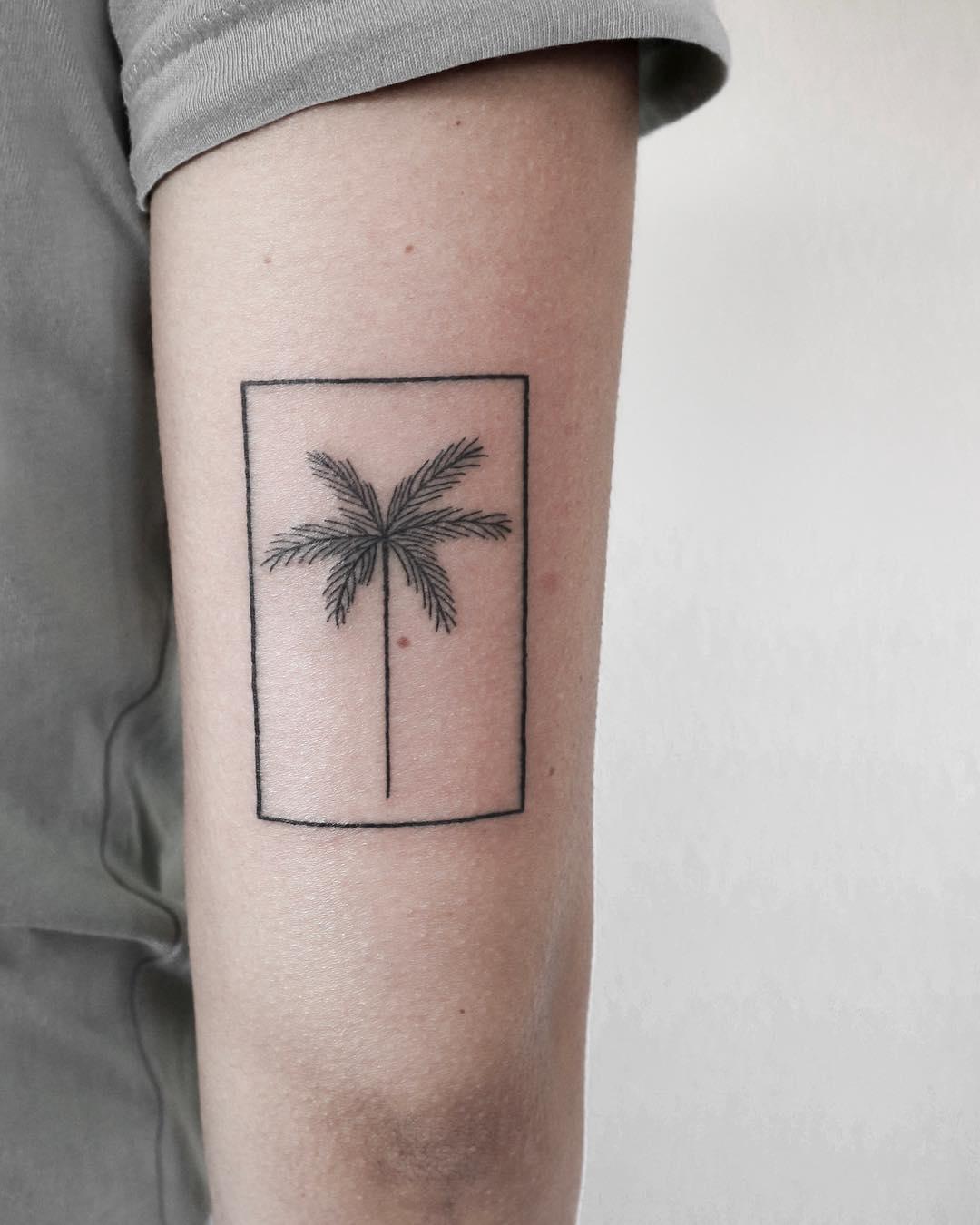A palm in a frame tattoo by Ann Gilberg