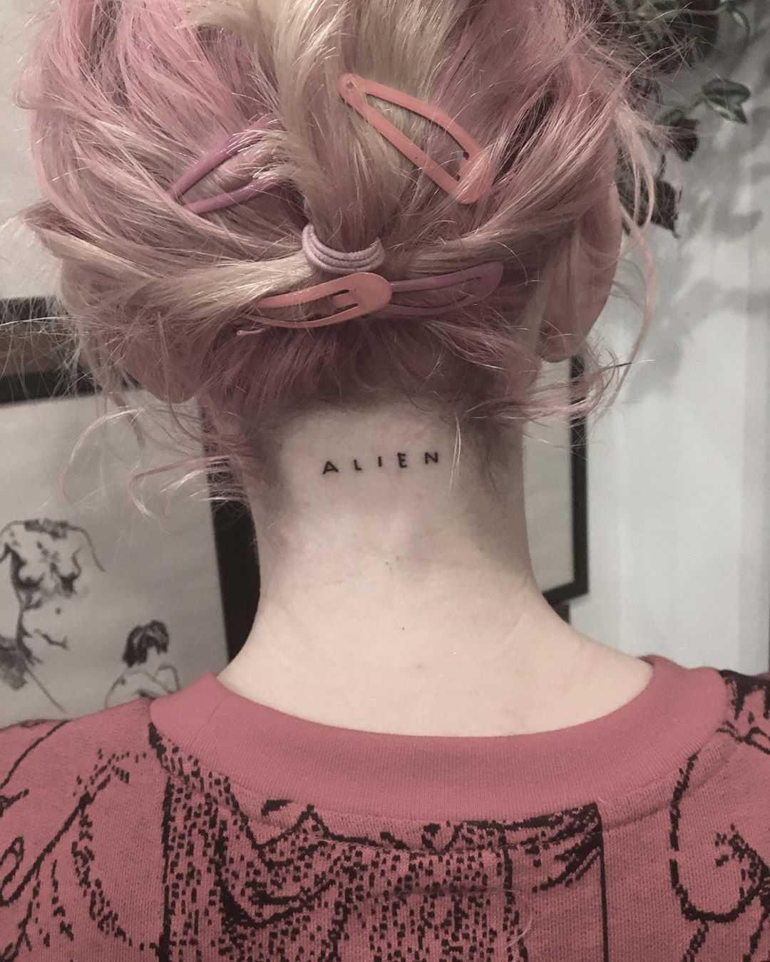 Alien tattoo by Robbie Ra Moore