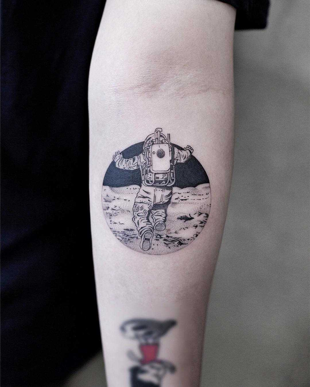 Astronaut on the moon tattoo by Aki Wong
