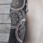 Beautifu black sleeve tattoo by Wagner Basei