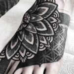 Black and grey foot tattoo by Wagner Basei